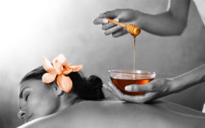 honey and sugar body scrub and a relaxing massage